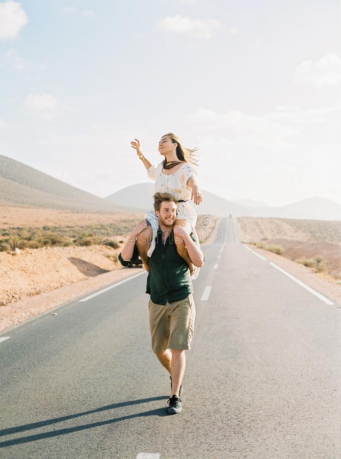 Couple walking on the road in Morocco. stock photography