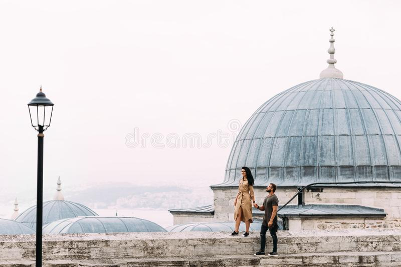 Couple walking on the roofs of Istanbul. Happy couple traveling to Turkey. Man and woman walking around Istanbul. stock image