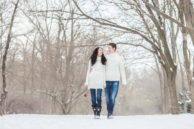 Couple walking with a rose stock image