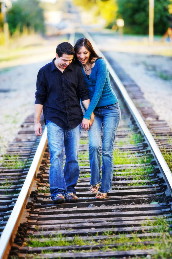 Couple Walking on RR track stock photos