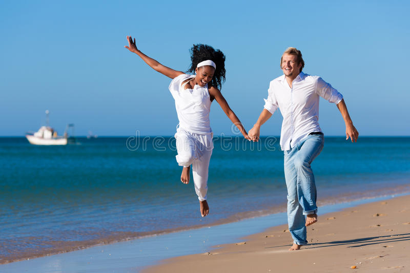 Download Couple Walking And Running On Beach Stock Photo - Image: 16421374