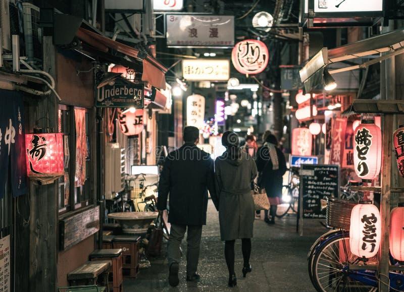 Couple Walking On Street At Night royalty free stock photo