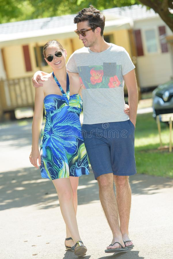 Couple walking wearing summer clothes stock photography