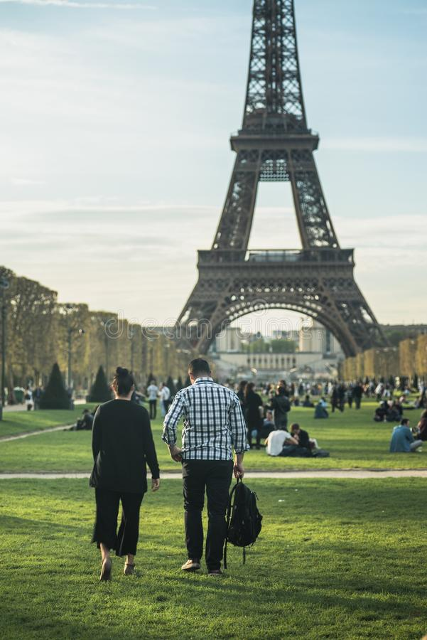 Finding a picnic spot under the Eiffel Tower royalty free stock images