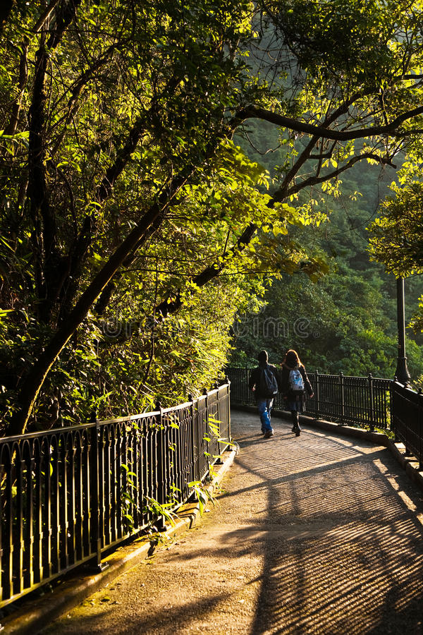 Couple walks the romantic peak way. In Hong Kong, Victoria royalty free stock images