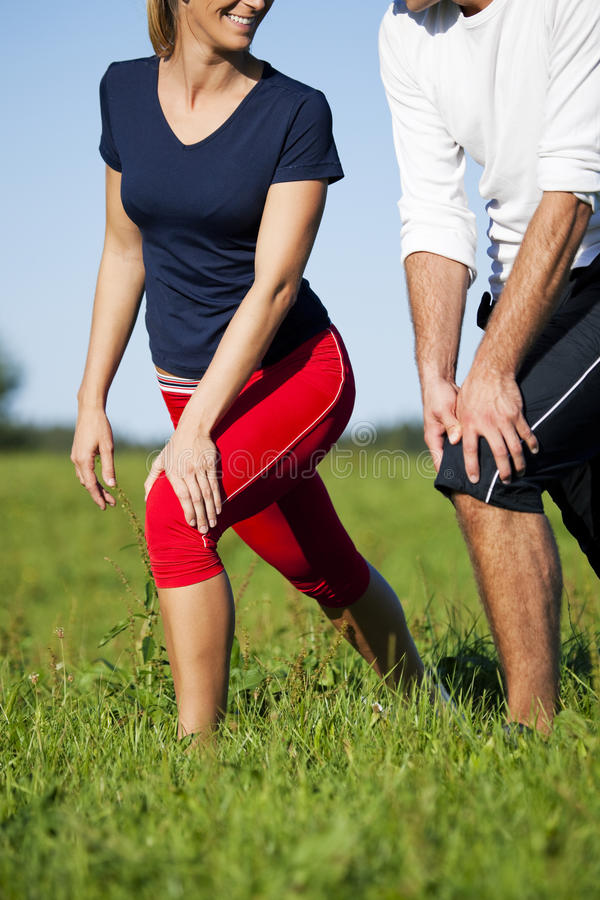 Couple warming up for exercise in summer stock photography