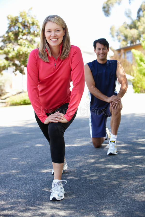 Couple warming up for a run stock photo