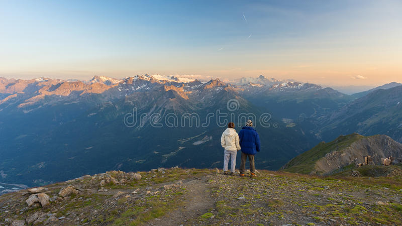 Couple watching panorama high up in the Alps royalty free stock photos