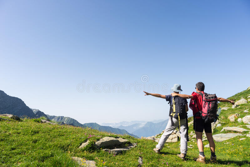 Couple watching panorama high up in the Alps stock photography