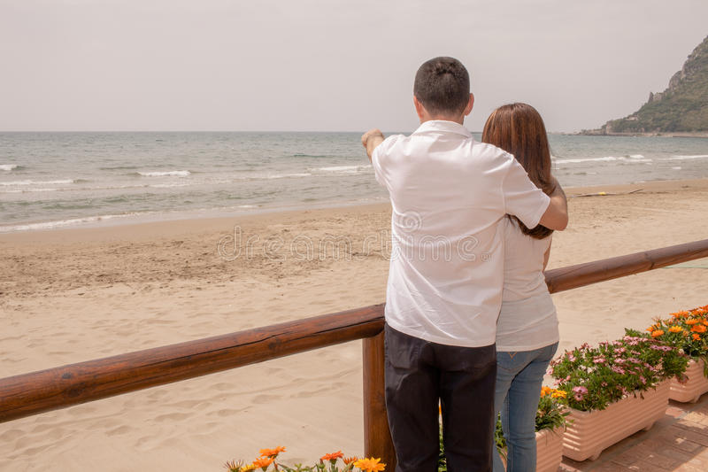 Couple Watching The Sea stock image
