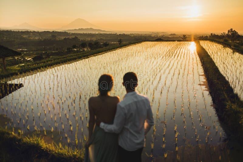 Couple watching sunrise on Jatiluwih, Bali royalty free stock photo