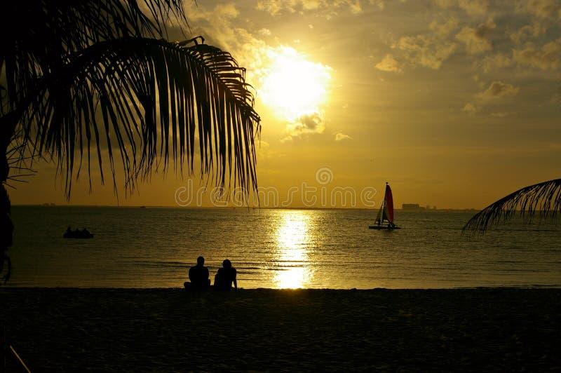 Romantic sunset in the beach stock image