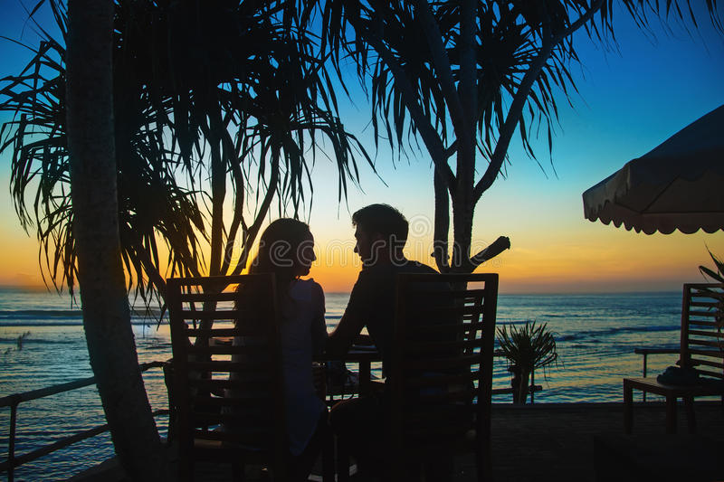 Couple watching sunset. From resort stock image