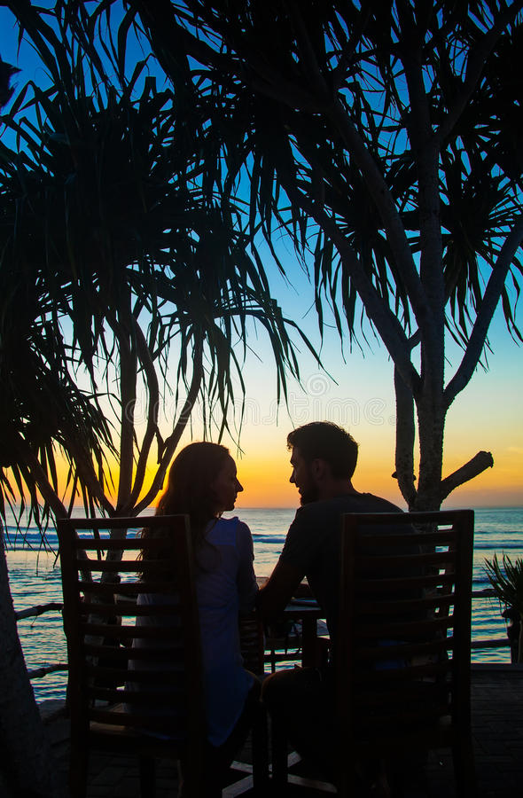 Couple watching sunset. From resort stock images