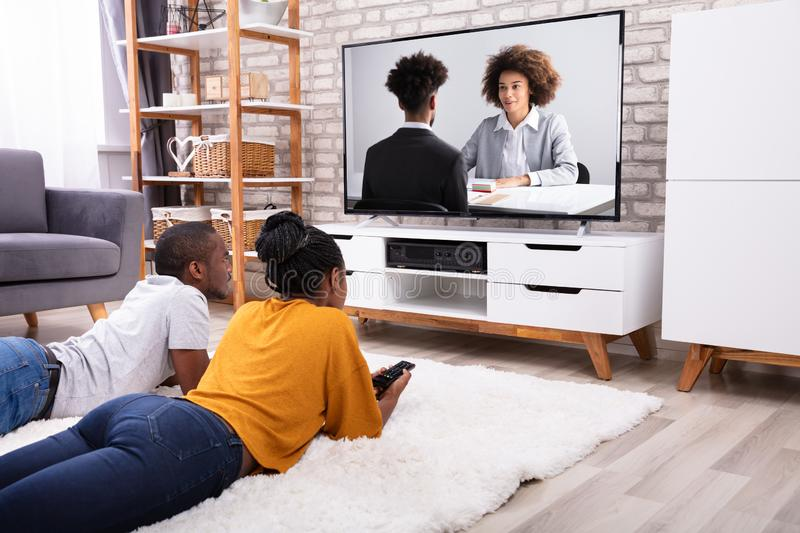 Couple Watching Television At Home stock photography