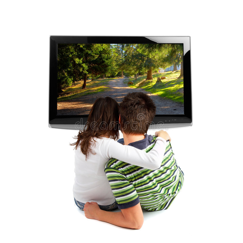 Couple watching TV. Rear view - isolated on white royalty free stock photo