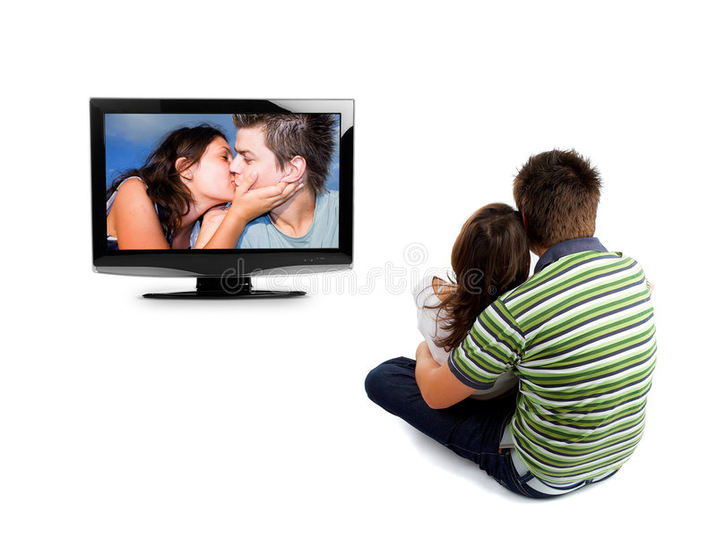 Couple watching TV. Rear view - isolated on white stock photography