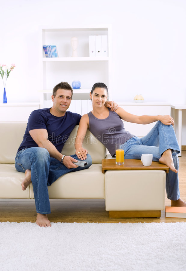 Couple watching TV royalty free stock photography