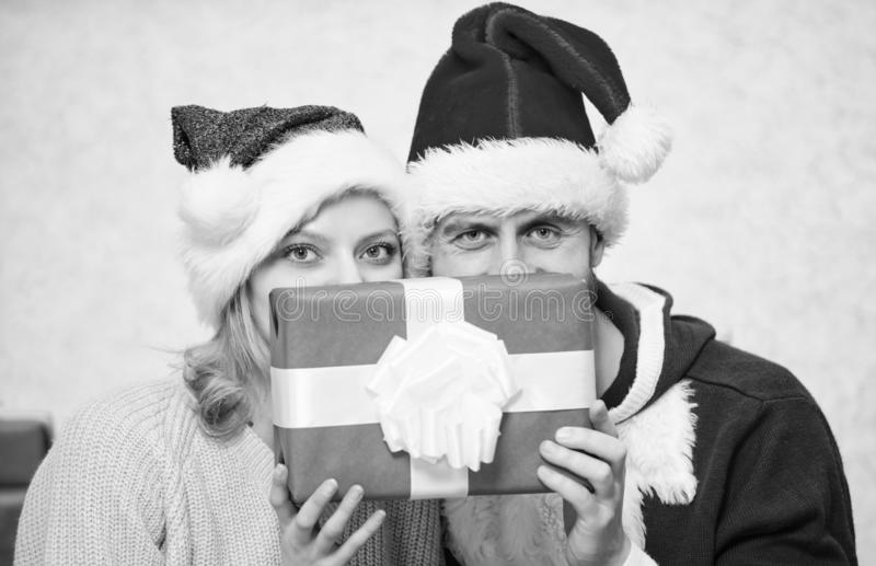 Couple wear hats as santa claus christmas tree background. Couple in love enjoy christmas celebration. It is easy to stock images