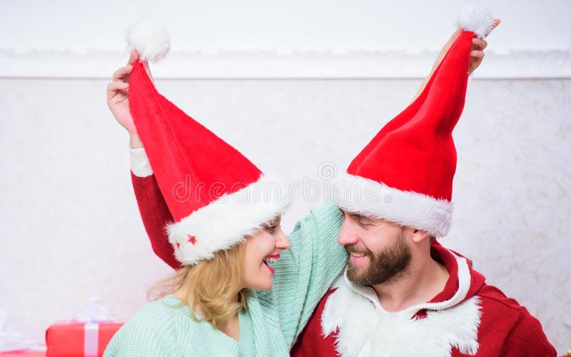 Couple wear hats as santa claus christmas tree background. It is easy to spread happiness around. Happy family celebrate royalty free stock photo