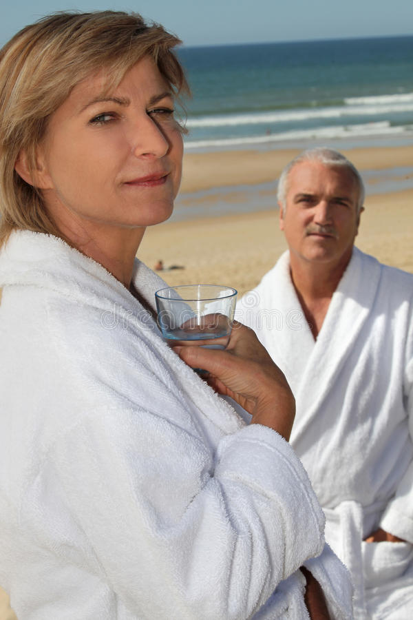 Couple wearing bathrobes royalty free stock photo