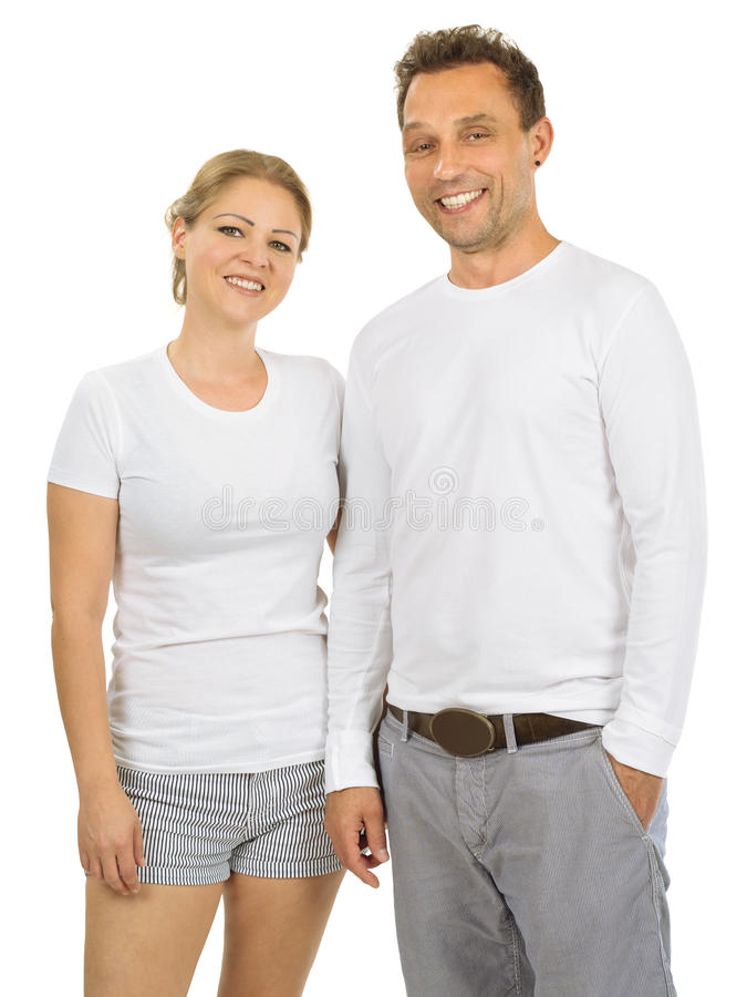 Couple wearing blank white shirts. Photo of a women and men posing with blank white shirts, ready for your artwork or design stock images