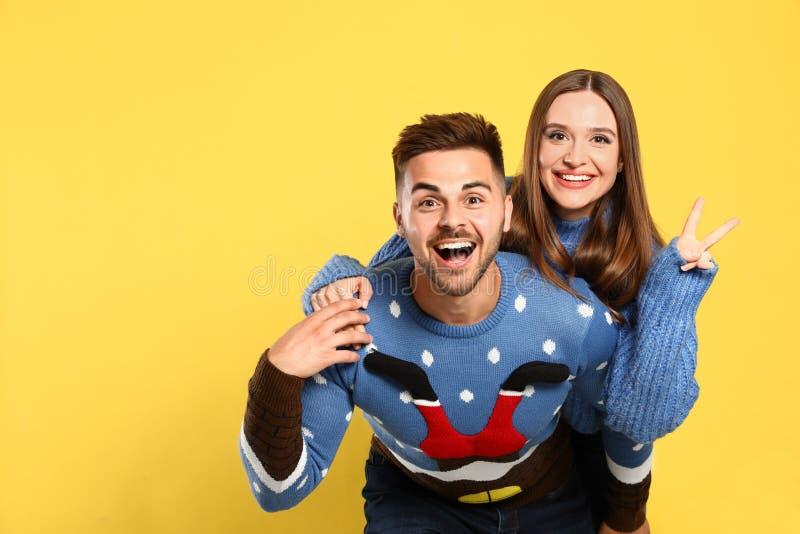 Couple wearing Christmas sweaters stock image