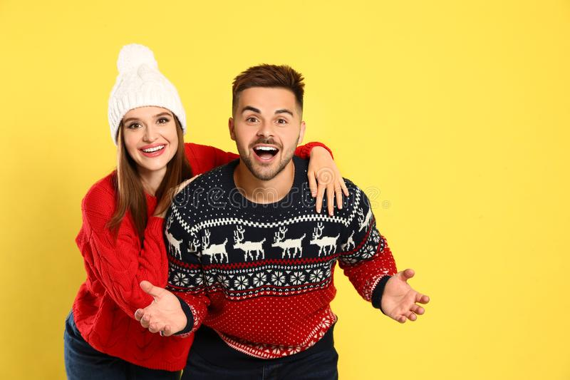 Couple wearing Christmas sweaters royalty free stock image