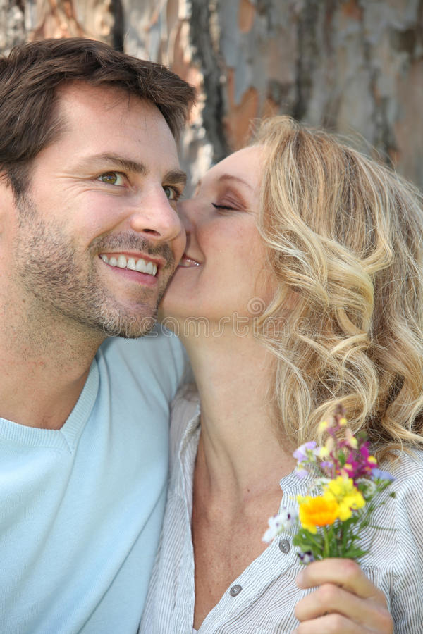 Couple With Wild Flowers Royalty Free Stock Image