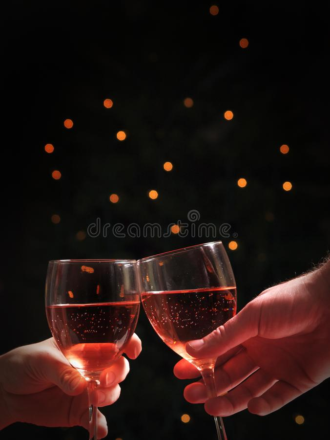 A couple with wine glasses. A couple on a date with wine glasses royalty free stock photo