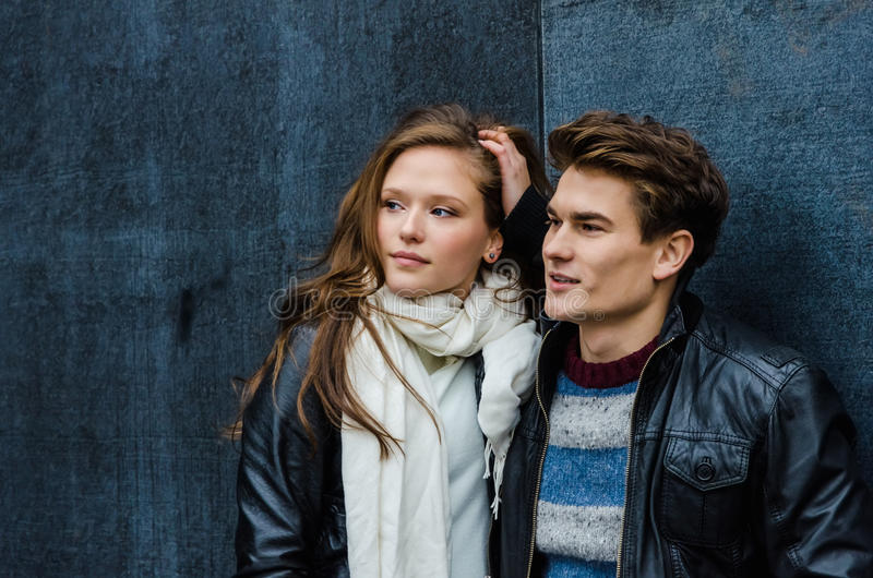 Couple In Winter Clothing Looking Away stock photos