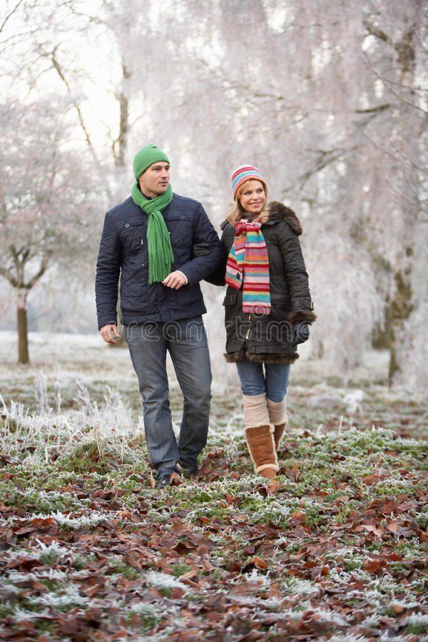 Download Couple On Winter Walk Through Frosty Landscape Stock Image - Image: 18919555
