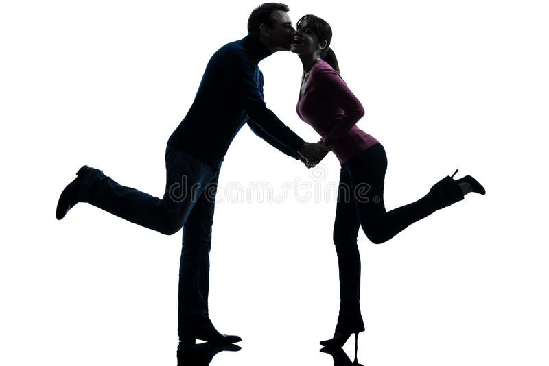 Couple woman man lovers kissing silhouette stock image