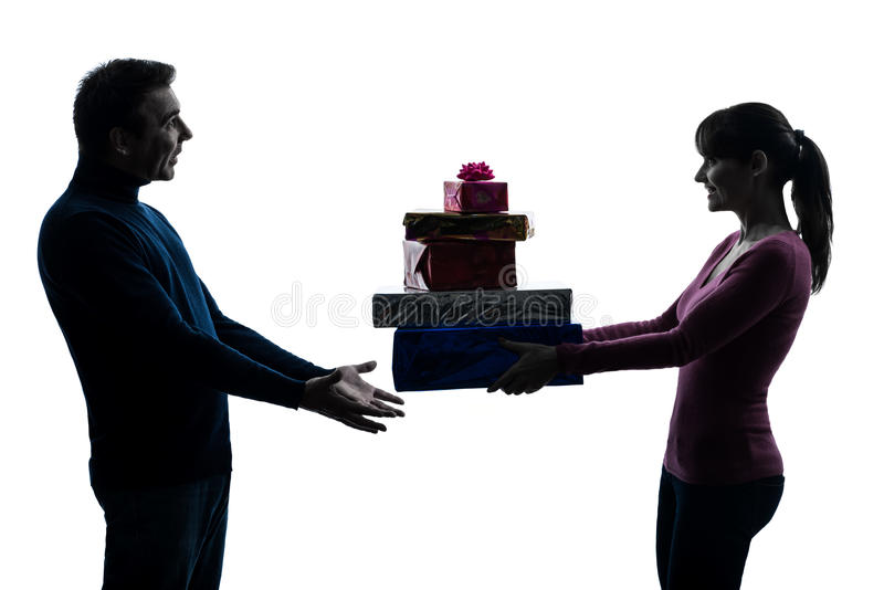 Couple woman man offering christmas gifts stock photo