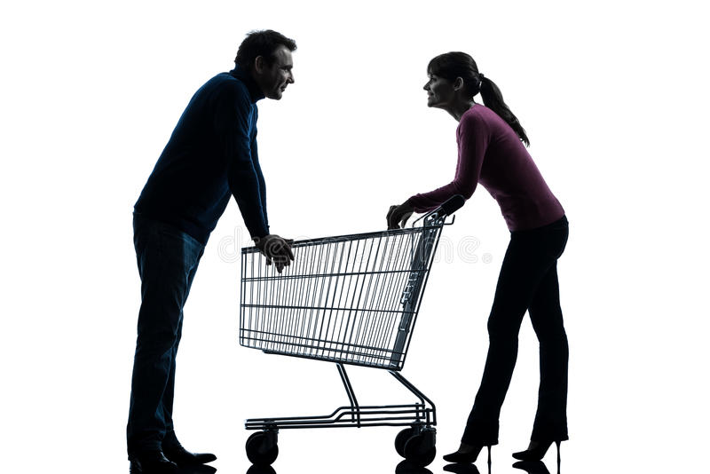 Couple woman man with shopping cart dating flirting silhouette. One caucasian couple women men with shopping cart dating flirting in silhouette studio on white royalty free stock photo