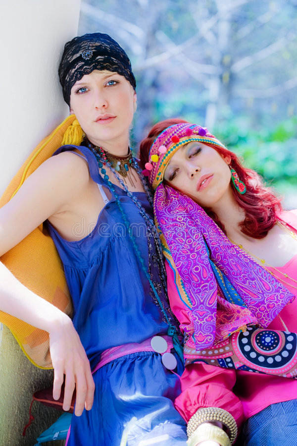 Couple of women resting in garden royalty free stock photography