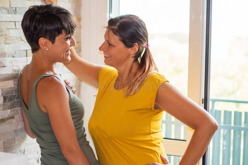 couple of women watching in the eye each other with love stock photo