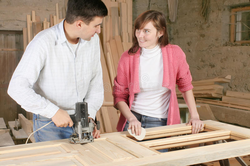 Couple in wooden workshop stock photos