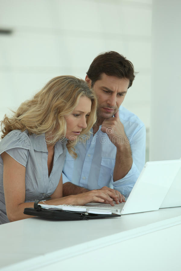 Couple At Work On Laptops Stock Photos