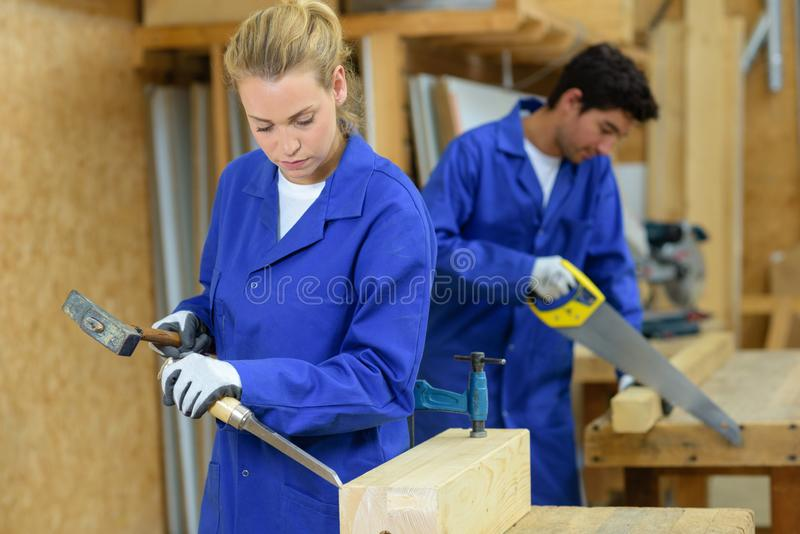 Couple workers woodworking royalty free stock photography