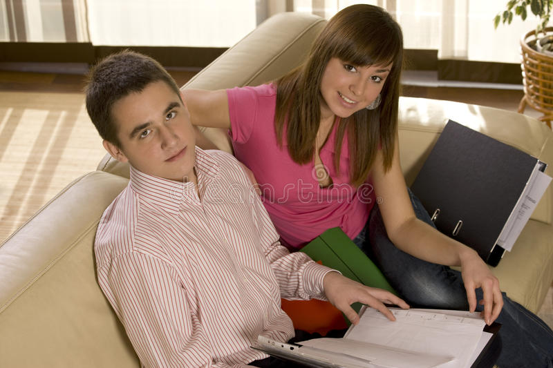 Couple working. In the living room royalty free stock image