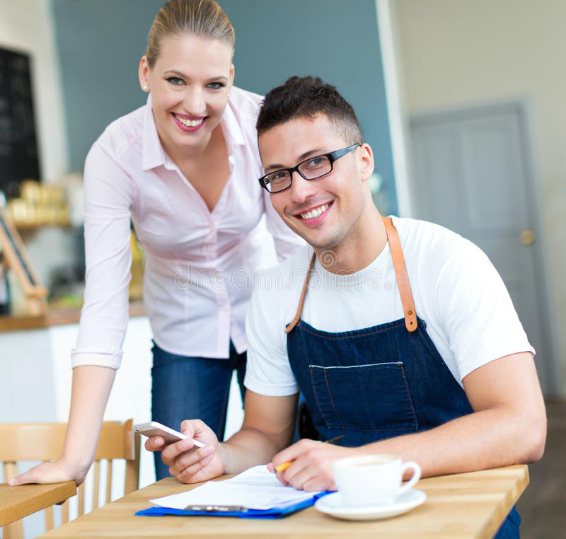 Couple working at cafe stock photos