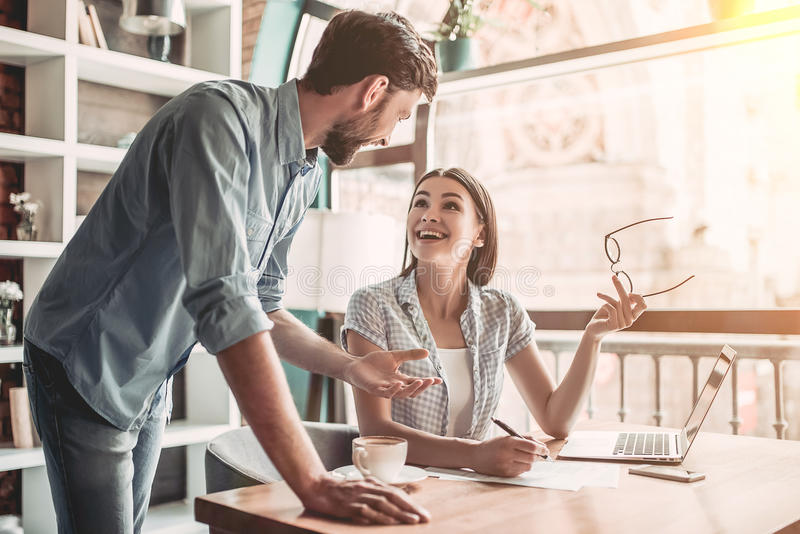 Couple working in cafe royalty free stock image