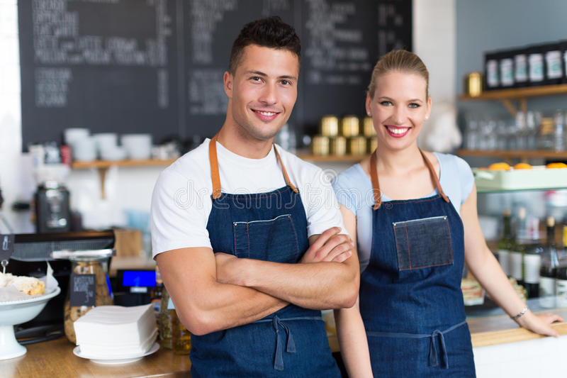 Couple working at coffee shop stock images