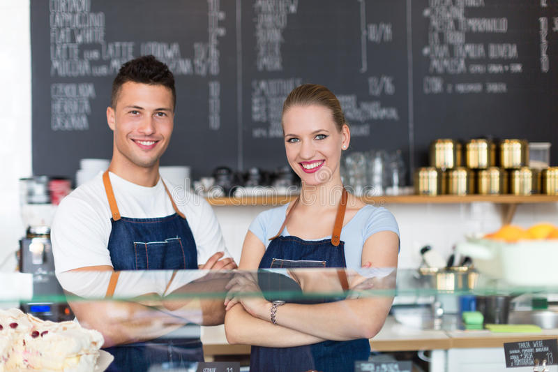 Couple working at coffee shop stock image