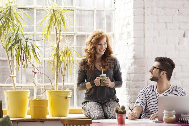 Couple working on freelance project stock image