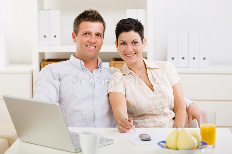 Couple working at home royalty free stock image