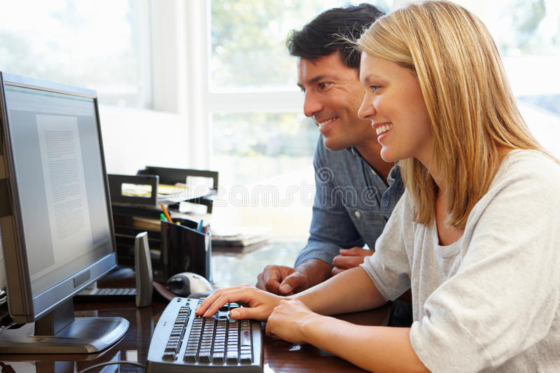 Couple working in home office stock photography