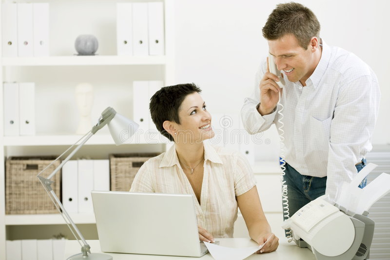 Couple working at home office stock images