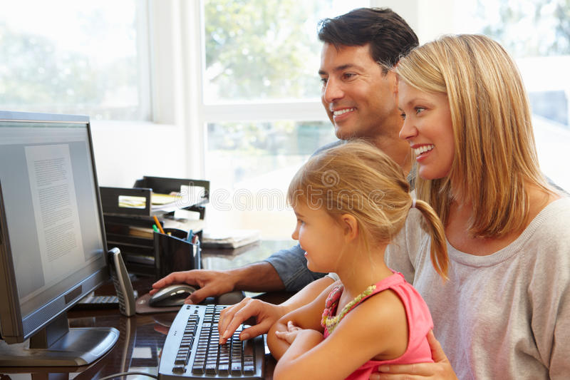Couple working in home office with daughter stock photos